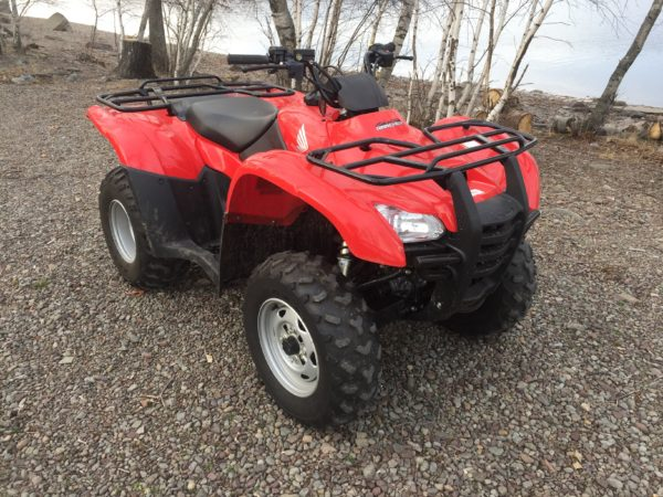 This quad is in like new condition and features 2 or 4 wheel drive with fuel injection